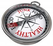 healthy versus junk food concept compass with black red letters isolated on white background poster