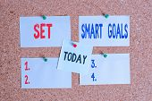 Text sign showing Set Smart Goals. Conceptual photo giving criteria to guide in the setting of objectives Corkboard color size paper pin thumbtack tack sheet billboard notice board. poster
