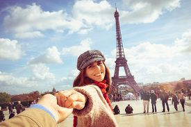 Traveler Girl In Vacation In Paris. Young Traveler Girl Leading Photographer In Vacation. Girl Trave