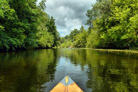 Couple Kayaking Together In River.  Tourists Kayakers Touring The River Of Ukraine.