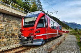 Bernina Express Train In The Mountains Of Switzerlandm Switzerland, Poschiavo