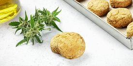 Cannabis Butter Cookies With Marijuana Buds And Cannaoil, Homemade Healthy Biscuits, Close-up Panora
