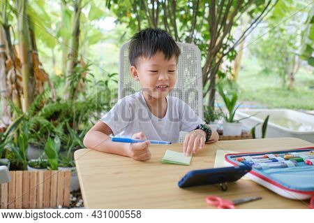 Cute Happy Smiling Asian Kindergarten Kid Enjoy Doing Arts And Crafts At Home On Nature, Little Boy