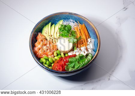 Poke Bowl On White Background. Poke With Raw Salmon And Fresh Vegetables. Traditional Hawaiian Food
