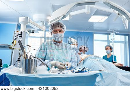 The Medical Team Performs The Operation - A Series Of Images Related To The Surgery. Real Modern, Op