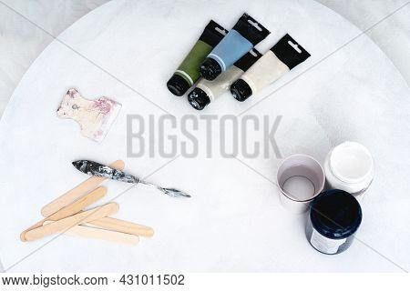 Artists Tools: Canvas, Paints, Matekhin. Artistic Background.