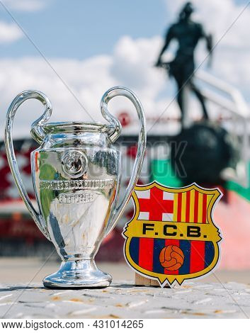 June 14, 2021 Barcelona, Spain. The Fc Barcelona Emblem And The Uefa Champions League Cup Against Th