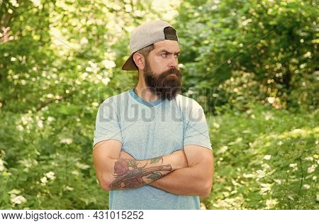 Get Off Your Feet In Heat. Brunette Bearded Man Wear Cap In Forest On Background Of Trees. Brutal Br