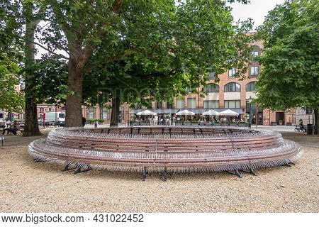 Brugge, Flanders, Belgium - August 4, 2021: Circular Bench On Burg Square Has Been Decked By Pigeon