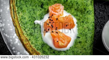 Green Spinach Crepes Or Pancakes With Smoked Salmon And Soft Cheese. Banner, Menu, Recipe, Place For