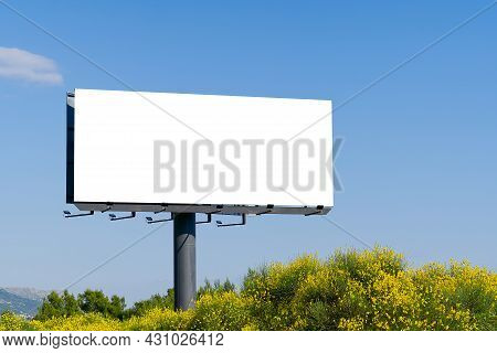 Blank Billboard Against Sky. Billboard - Large Blank Billboard With Empty Screen And Beautiful Sky F