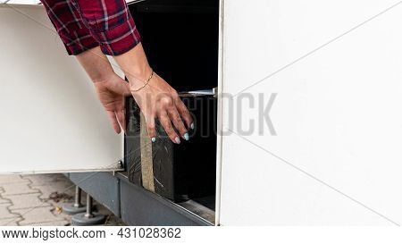 Automated Locker. Parcel Courier Box In Woman Hands At Post Delivery Automat Terminal. Courier Puts