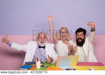 Funny Excited Business People. Group Of Joyful Excited Businesspeople Having Fun In Office, Using La