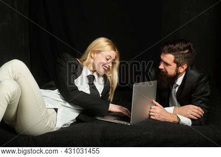 Couple Look At Laptop Screen, Excited Happy Young Husband And Wife Using Laptop, Reading News, Shopp