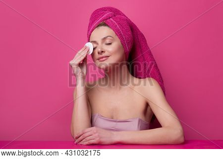 Young Woman Enjoys Spa Procedures, Wrapped Towel On Head, Isolated On Studio Background. Morning Tim