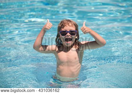 Child In Summer Swimming Pool. Cute Child Boy With Thumbs Up Swim In Swimming Pool, Summer Water Bac
