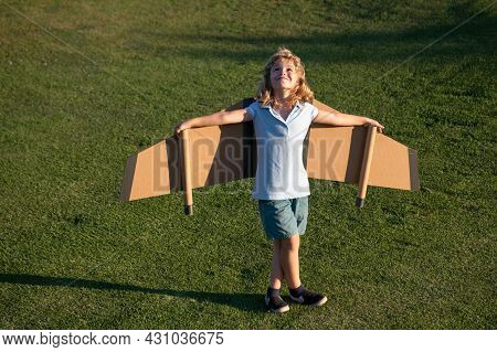 Child Boy Playing And Dreaming About Summer Vacation And Travel. Kids Imagination And Freedom Concep