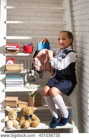 School Girl Preparing Backpack For School. Education For Kids. Back To School. Little Schoolgirl Col