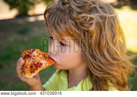 Child Eating A Piece Of Pizza. Kid Boy Eat A Slice Of Pepperoni Pizza. Funny Kids Face. Pizza The Be