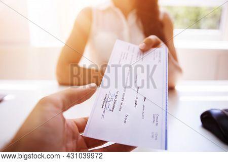 Handing Payroll Cheque To Employee. Salary Check