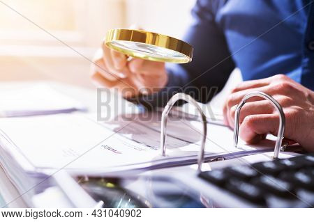 Businessman Investigation Finance Using Magnifying Glass. Fraud And Audit