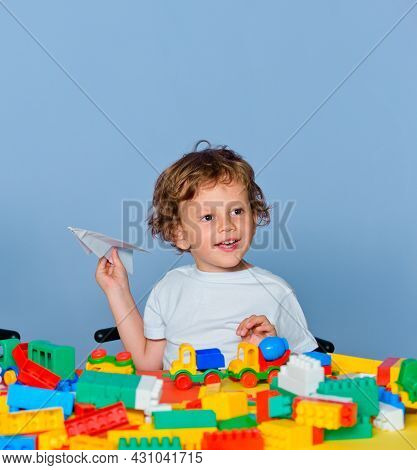 Cheerful Smiling Little Pupil Having Fun. Little Ready To Study. Kid School. Little Boy Pupil With H