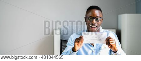 Holding Paycheck In Office. Businessman Payroll Pay