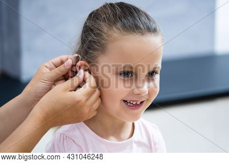 Audiology Hearing Aid For Child. Audiologist And Deaf Disability