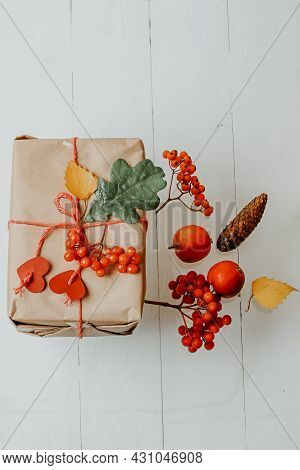 Box With Autumn Gift Wrapped In Kraft And Tied Rope With Hearts. Eco-friendly Biodegradable Packagin