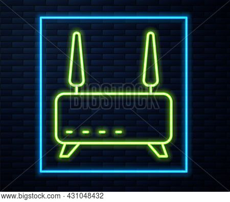 Glowing Neon Line Router And Wi-fi Signal Icon Isolated On Brick Wall Background. Wireless Ethernet