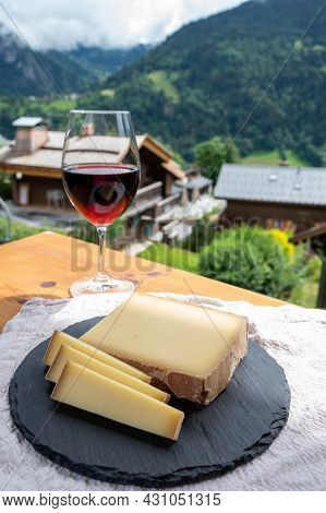 Cheese Collection, French Cow Cheese Comte, Beaufort, Abondance, Red Wine From Savoie And French Mou