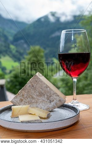 Cheese Collection, French Cheese Tomme De Savoie, Glass Of Red Wine From Savoie And French Mountains