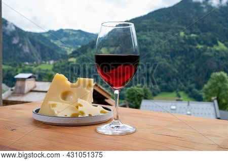 Cheese Collection, French Cow Cheese Emmental, Glass Of Red Wine From Savoie And French Mountains Vi