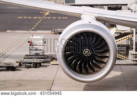Close-up Image Of The Jet Engine And Part Of The Wing Of A Modern Jet Airplane, Airport Ground Servi