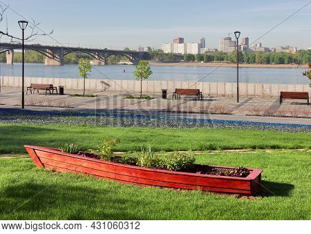 Novosibirsk, Siberia, Russia - 05.25.2020: Boat On The Lawn On The Embankment. A Decorative Wooden B