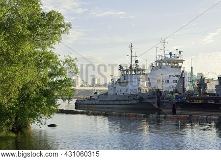 Novosibirsk, Siberia, Russia - 05.25.2020: Two Tugs With A Barge At A Floating Pier On The River In