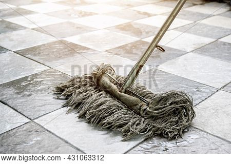Clean Tile Floors With Mops And Floor Cleaning Products.