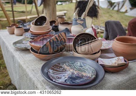 Craft Ceramist Demonstrates The Products Of His Work On The Festival Workshop, Clay Jars And Pots At