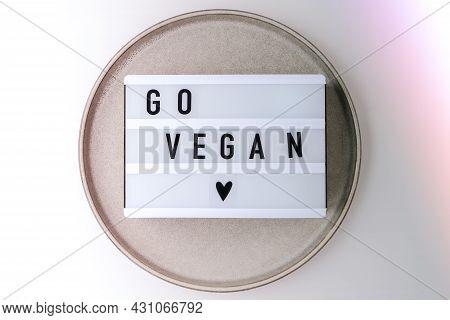 Lightbox With Text Go Vegan In Plate. Veganism, Vegetarian Healthy Lifestyle.