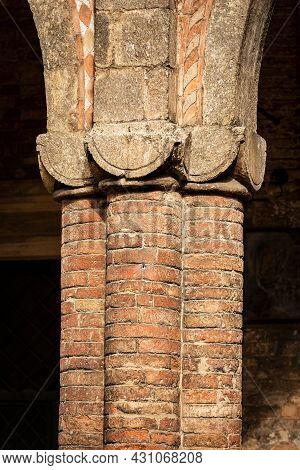 Closeup Of Ancient Brick Columns Of The Basilica Of Santo Stefano Also Known By The Name Of The Seve