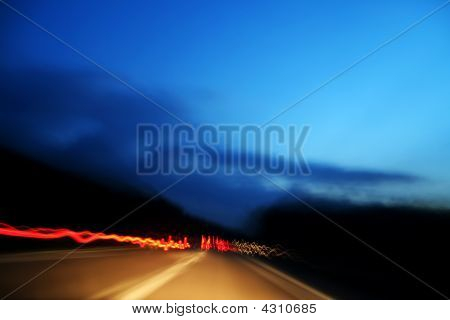 Red Lights Made From Fast Car In Highway