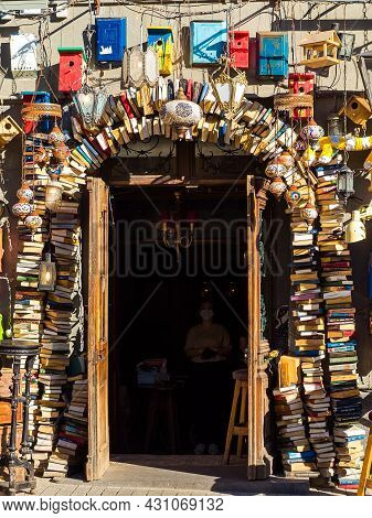 Moscow, Russia - May 24, 2021: Entrance To A Cafe Decorated With Antiques: Book, Lamps, Birdhouses A
