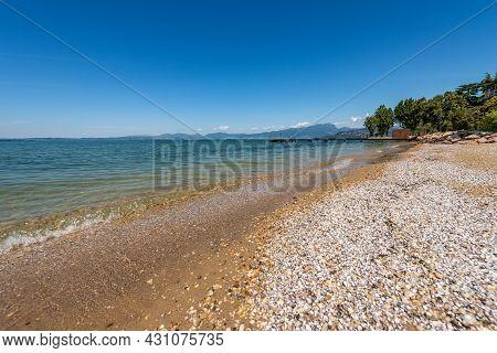 Beautiful Empty Beach On Lake Garda (lago Di Garda) Between The Small Villages Of Lazise, Bardolino