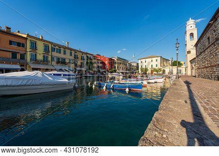 Port Of The Small Lazise Village, Tourist Resort On The Coast Of Lake Garda (lago Di Garda). Ancient