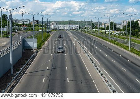 Multi-lane Highway With A Dividing Strip. Automobile City Road On A Summer Day.