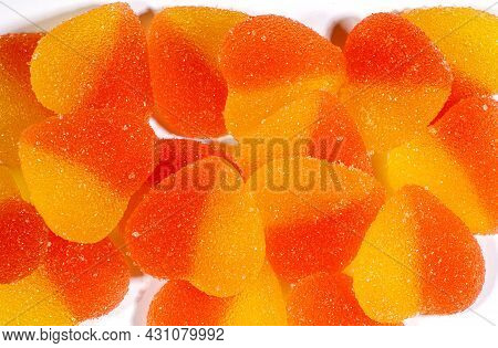Background Of Many Marmalade Hearts On White. Heart-shaped Candy.
