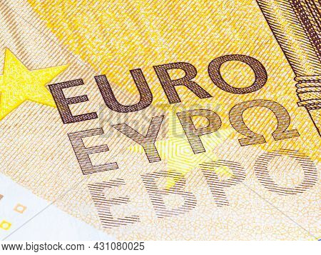 Fragment Part Of 50 Euro Banknote Close-up With Small Details. Yellow Brown Banknotes From European