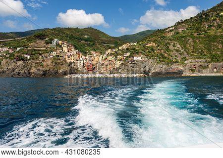 Riomaggiore Village Seen From The Mediterranean Sea, Cinque Terre National Park In Liguria, La Spezi