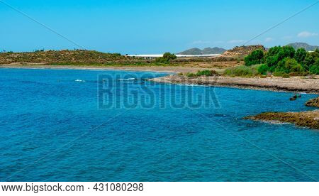 a view over the lonely Playa del Rafal beach, in Aguilas, in the Costa Calida coast, Region of Murcia, Spain