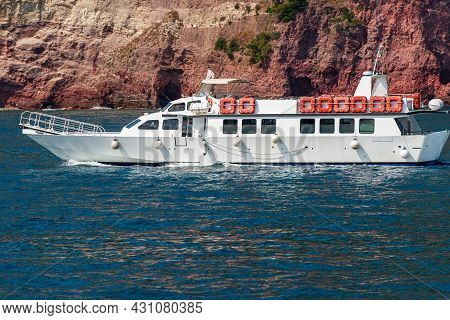 Empty White Ferry Boat In Motion In Front Of The Rocky Coast Of The Cinque Terre National Park, Unes